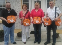 Members of the Loughmore/Castleiney Defibrillator Group in Tipperary Receiving five IPAD AEDs