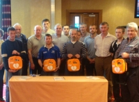 Members from the Irish Tug of War Association receiving 4 X IPAD AEDs and Training From Eiremed